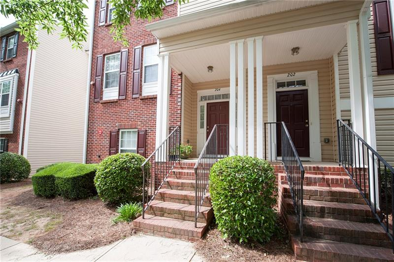 Spacious end-unit town home in swim/tennis community with easy access to HWY 575 and downtown Woodstock.  Kitchen w/ island, stainless steel appliances, opens to great room/dining room combo.  Vaulted ceiling in master and huge closets. Bonus room in finished basement. 2 car garage.