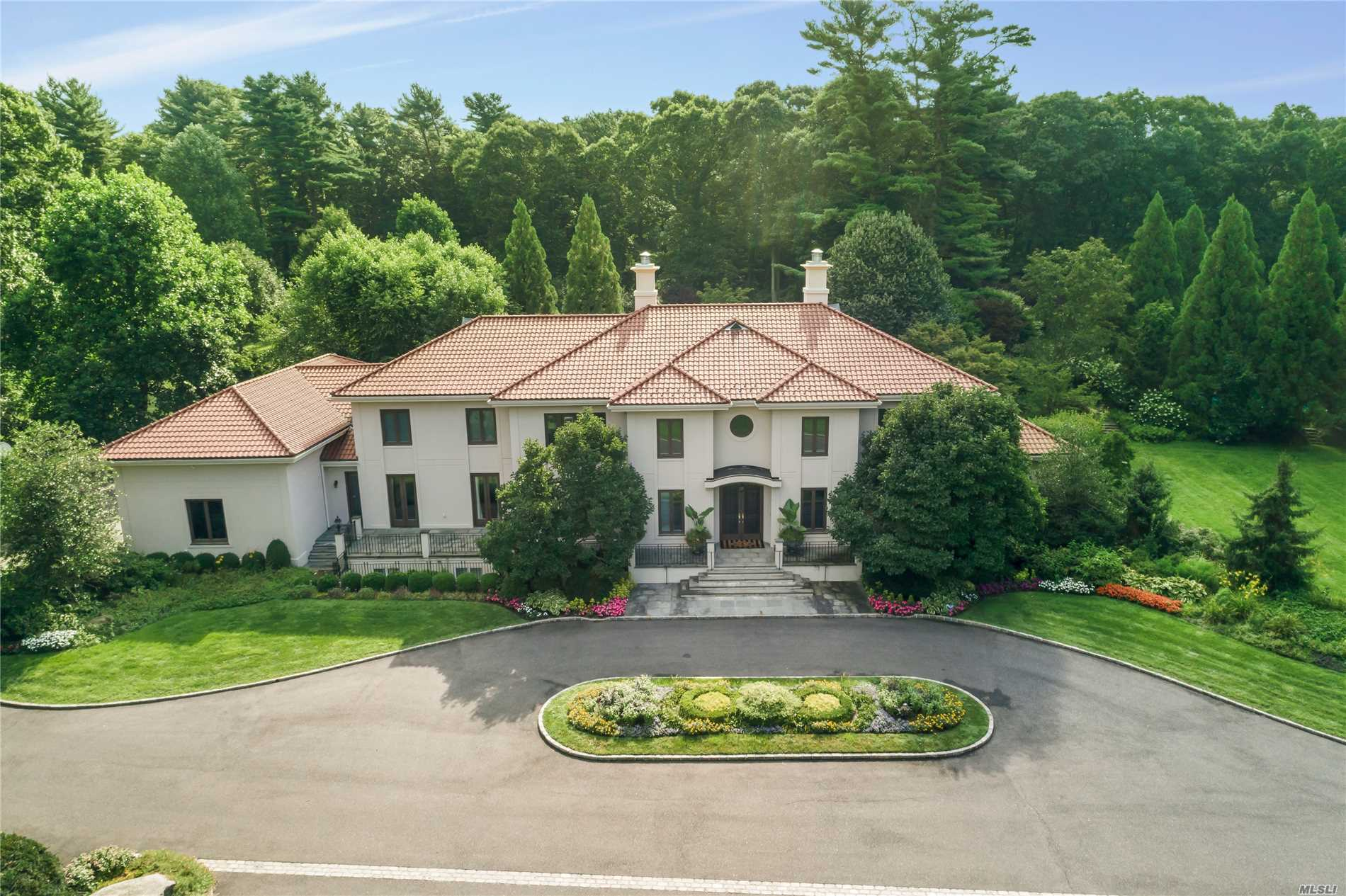 Grand Sun-Filled, 7 Acre, 8,000 Sq. Ft. Exquisite Estate Complete With Two Master Bedroom Suites; One On The First Floor With Sitting Room & Fireplace, Second Master On 2nd Floor, 7 Car Garage-5 Attached, 4 Family Ensuite Bedrooms, Three Fireplaces, Wine Cellar And More. Complete With An Outdoor Kitchen, Pool, Majestic Trees, Basketball Court; Located In Award Winning Lv School District. International Baccalaureate Program. Ease Of Access To Major Highways, Great Nyc Commute.