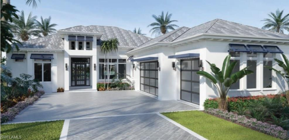 """Introducing the Abaco on Lot 21. A Qucik Delivery home featuring 3200 square feet (4642 total) that includes four bedrooms, 3.5 baths, great room, spacious kitchen with an island, natural gas, walk-in pantry, outdoor kitchen, pool & spa, 3 car garage and the highest level of specifications. Located in """"The Peninsula at Treviso Bay"""", a distinct enclave of 55 home sites, surrounded by unparalleled views of the breathtaking TPC Treviso Bay golf course, lagoon and preserve. Offering five coastal and transitional style models, ranging from 3,196 square feet to 4,687 square feet under air. Each model can be further customized through a host of optional features to uniquely fit your lifestyle. The distinctive floor plans boast an open-concept that flow seamlessly, emphasizing the amazing views and outdoor living spaces. All homes come with a full golf membership, too! Base price of the Abaco plan is $1,695,000. Lot premiums range from $0 to $350,000. List price includes the premium for this lot."""