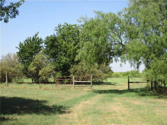 Beautiful +/-23.705 acres of rolling land with both native and improved grasses, tract can be divided into larger than 10 acres each.  This property is perfect for a weekend getaway or horse or cattle operation.  The property has two barns that are in average to fair condition and an older mobile home in fair condition. new septic would be required.  Property is fenced/cross fenced and is easy commuting distance to Austin.  This could be a real showplace! Includes tax ID 095969 and 008605.