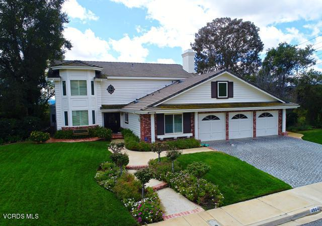 Updated Morrison Sutton home with beautiful mountain and valley views! Four bedrooms and three bathrooms, including a downstairs bedroom and full, remodeled bathroom. Gourmet kitchen with granite counters, built in refrigerator, double oven, center island, and eat-in breakfast area. Formal living room with fireplace and formal dining room. The family room has beautiful wood floors, fireplace, & crown molding and opens to an extra, bonus room area. The master bedroom suite has a walk-in closet and separate sitting area with fireplace. Remodeled master bathroom with granite counters, dual vanity, separate tub and oversized shower with dual shower heads. Features include inside laundry room, newer dual pane windows with plantation shutters, recessed lighting, and vaulted, smooth ceilings. Attached three car garage. Enjoy the entertainer's yard with mountain/city views, the relaxing spa and covered patio area. A private retreat to call home.