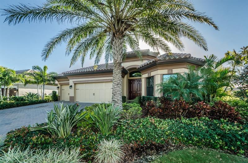 THIS 2 YEAR NEW EXPANDED BISCAYNE MODEL BOASTS 2832 SQ. FT. HEATED. 4 BEDROOMS, 3 BATHS AND A 3 CAR GARAGE WITH THE OPTIONAL SUNROOM. LOT 27 IS AN OVERSIZED, MANOR HOME LOT ON THE 11TH HOLE OF THE ISLAND GOLF COURSE. IN ADDITION TO THE MANY WESTBAY UPGRADES IN THIS HOME, THERE ARE SOME ADDITIONAL SIGNIFICANT IMPROVEMENTS. THIS IS THE ONLY HOME IN THE PROMONTORY WITH PGT IMPACT HURRICANE WINDOWS AND DOORS. THESE WINDOWS AND DOORS ELIMINATE THE NEED FOR HURRICANE SHUTTERS AND SIGNIFICANTLY REDUCE YOUR UTILITY BILLS, HOME OWNERS INSURANCE COSTS AND OUTSIDE NOISE. ALL OF THE APPLIANCES HAVE BEEN UPGRADED TO INCLUDE DOUBLE CONVECTION OVENS W/ A WARMING DRAWER AND A VENTED MICROWAVE. THE GAS STOVE AND TANKLESS HOT WATER HEATER ALSO REDUCE YOUR ELECTRIC COSTS AND PROVIDE ADDED VALUE AND COMFORT. THE LARGE  MASTER BATH HAS A BIDET AND DUEL VANITY SINKS. THE HOME INCLUDES A STATE OF THE ART WATER FILTRATION AND SOFTENING SYSTEM AND UPGRADED SECURITY SYSTEM.  THIS IS THE ONLY ONE STORY HOME IN THE PROMONTORY PRESENTLY ON THE MARKET. WE HAVE A NEW CERTIFIED APPRAISAL ON THIS HOME, A SURVEY AND FLOOR PLAN. THIS HOME IS A MUST SEE. PRICE REDUCED TO $ 15,000 BELOW CURRENT APPRAISAL.