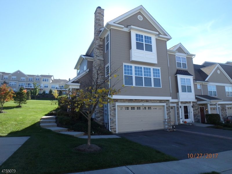 End unit Aspen Model townhouse style condominium with 3 BR 2.5 baths.  Fireplace in LR, hardwood floors main level, carpet in bedrooms and in the finished basement, ceiling fans in bedrooms.