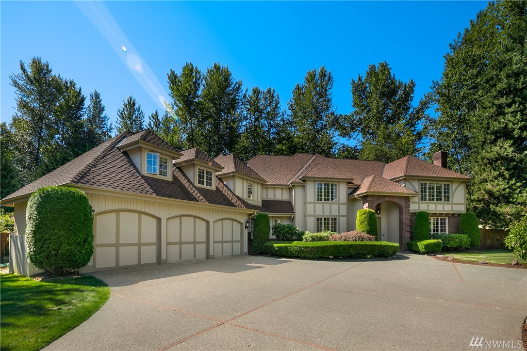 Commanding street presence, sweeping circular drive, on cul-de-sac. 4,400 sqft. Level sunny 2/3 acre lot. Light, bright interior w/9-ft & vaulted ceilings, gourmet kitchen, SS appliances, granite counters & butler's pantry. 5 BDR + non-conforming 6th bdr or hobby rm. Spacious master & ensuite. Formal liv & din rm. Generous interior & exterior entertaining areas. Sprawling lawn, fruit trees & mature gardens. Superior Northshore schools. Easy access to Freeways. Close to Woodinville Wine Country.