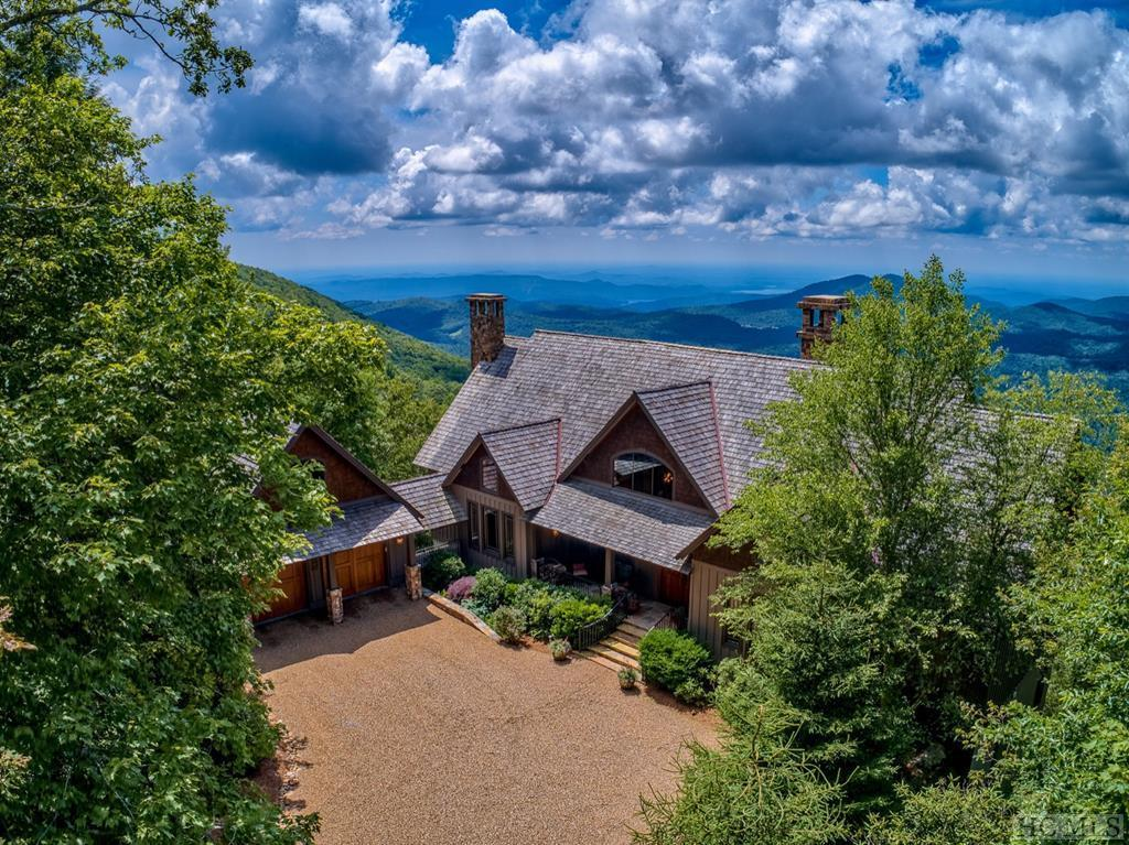 Possibly the most spectacular long-range and layered views to be seen from The Plateau. Views are panoramic encompassing Whiteside and Mountaintop as well as the SC lakes Jocasse and Keowee and Lake Hartwell in Georgia. For the first time, this four bedroom, four and a half bathroom home is on the market. Located in the fine subdivision of Falcon Ridge on over 8 acres at 4,300'. Rock Creek runs alongside the house and throughout the property for a great natural water feature. The stunning home has been carefully designed to encompass the desirable southerly mountain views from all the bedrooms and master bathroom as well as the living rooms. In addition to the superbly creative and unique bathrooms, the home offers a mix red oak, slate and carpeted flooring, office on the main level, lower level family room and wine room. There are three massive stone fireplaces inside and out each with unique designs and custom mantels. Located at the end of a cul-de-sac for ultimate privacy. Falcon Ridge offers a community pavilion for annual picnics or just walking the dogs. There is private access to miles and miles of trails in Panthertown National Forest for the hikers in the family. Take the virtual tour to see all this home has to offer inside and out.