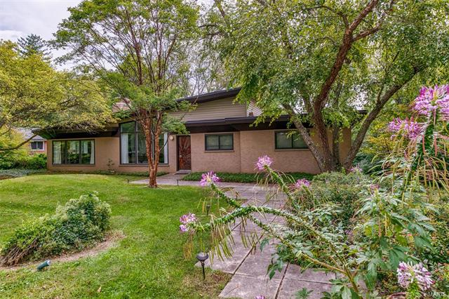 The home of the renown late sculptor, Saunders Schultz, is available for the first time. An example of Schultz's works can be seen in front of Caleres in Clayton and his works span across the world. The home was designed by famed architect Richard Cummings and renovated by the Schultzs in the 70's. The hallmark of the home are the expansive windows making each view complete and bringing the outside natural world into the house as part of the internal environment. The front door was designed by Schultz with hand carved three dimensional wooden pieces. The living room and den share a gas see-through fireplace. Sliding doors in the den lead to a secluded deck. The kitchen features a breakfast room and doors that take you to a second deck. The property located on a .56 acre private lot with neighbor's lots joining in the back to create a park-like setting. Ladue Schools. 2-car garage.