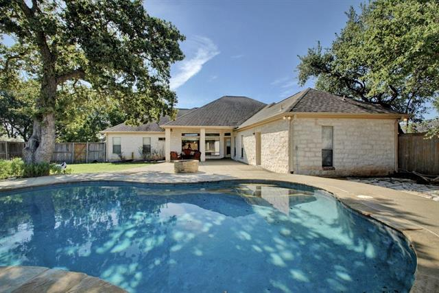 Elegance is what you will find in this Brick and Stone one story on 1.32 acres in The Woods of Fountainwood.  This home is surrounded by mature trees and beautiful deer roaming freely.  The open floor plan features large rooms, tile floors and huge walk-in closets.  The kitchen is an entertainers dream with silestone countertops, tile backsplash, sub-zero refrigerator and built-in ovens.  Windows of the family room overlook large covered patio and pool for relaxing on hot Texas summer days.