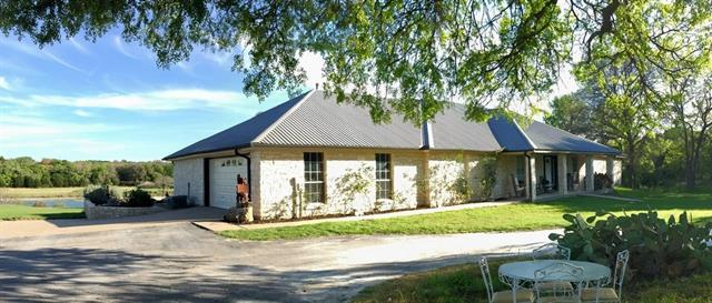 Limestone custom home on a 100 acre ranch with great water in Lampasas County.This 100 acres consists of wooded pastures, good paved road frontage, fields, and Fall Creek.The creek is gorgeous with a 2-3 acre pond and concrete dam. 3000+ SF custom limestone home, guest manufactured home, stone entry, and ¾ of the property is high fenced.There is an additional 306 acres of wooded hunting and recreational land available that is part of the main ranch for a combined price of $2,100,000. See separate listing.