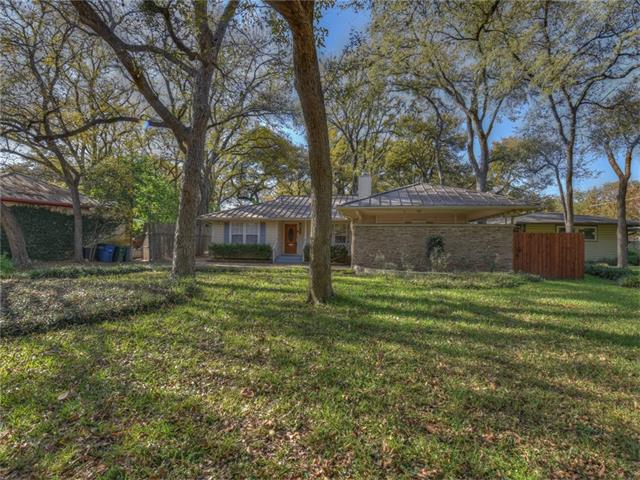 Huge lot with Fabulous Trees! Excellent Location! 3 Bed 1 & 1/2 bath. House needs updating.(Hardwood Flooring under Carpet) Updated A/C system & Tank-less Water Heater. Wood Burning Fireplace in Living. House has great curb appeal. Private Backyard is Amazing with Covered Deck & Giant Trees .