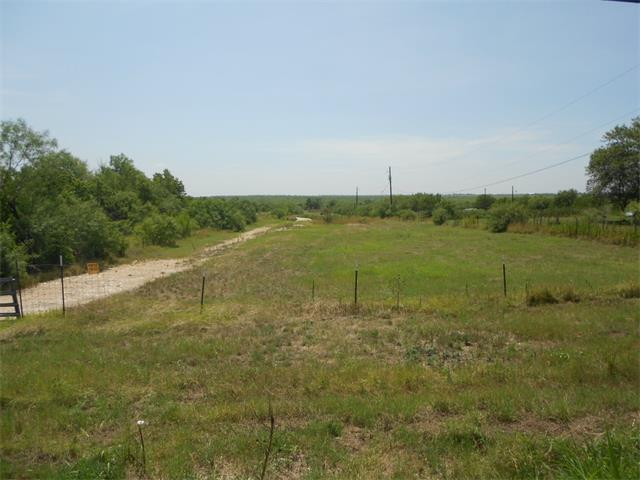 Great Opportunity for Investors for 50+ Acres.  Directly Across Elroy Road from Formula One Race Track.  Near Side Entrance to Track. Mixed Use Potential for Commercial, RV Park, Retail, Restaurant. Unimproved Ranch Land Property, with Wet Weather Creek, 4 Oil Wells, many Mesquite trees. On-Site Travel by vehicle is at your own risk of mesquite thorns in tires. Tax Parcel 300325 - 54.6340 Ac (Previously were two parcels).  OWNER FINANCE TERMS AVAILABLE, MIN $50,000 DOWN. Finance at 8% for up to 30 years.