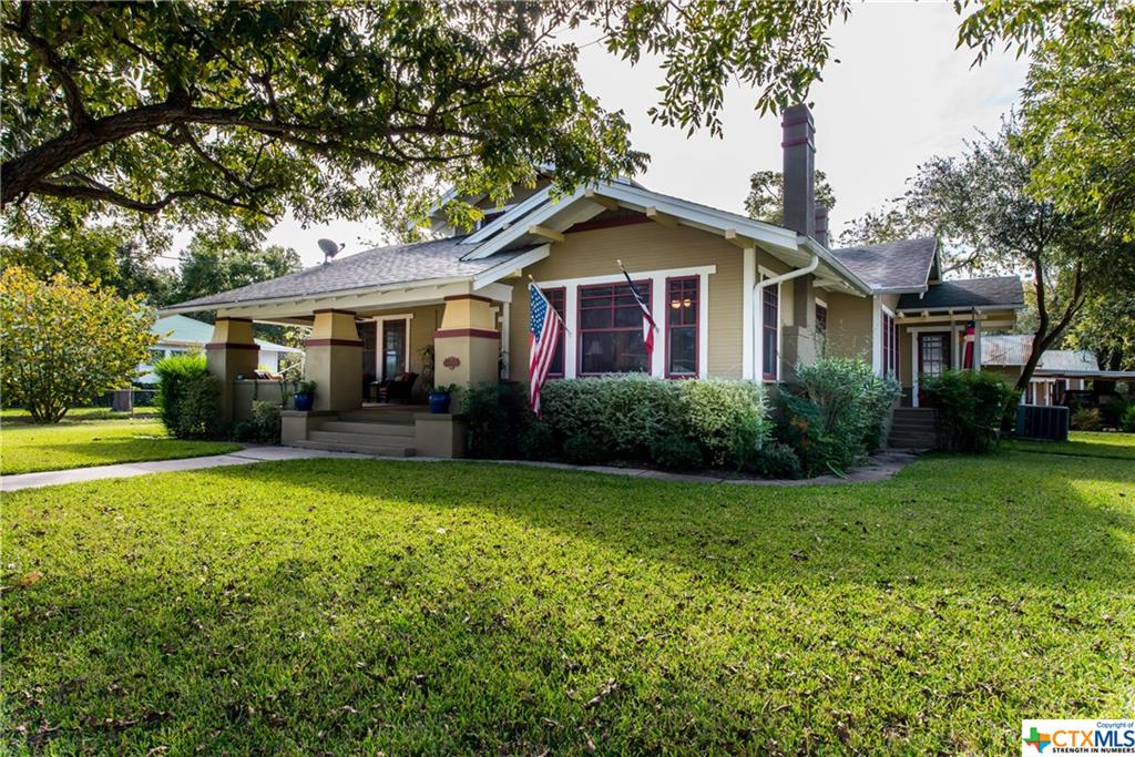 CHARMING CRAFTSMAN IN THE HEART OF SEGUIN.   THIS CIRCA 1919 HOME FEATURES WOOD FLOORS, NUMEROUS CUSTOM ACCENTS AND BUILT-INS, ORIGINAL POCKET DOORS, AND HUGE FRONT PORCH FOR WATCHING THE WORLD PASS BY.   LARGE CORNER LOT WITH MATURE TREES, DETACHED GARAGE & CARPORT, GUEST QUARTERS AND AN ABOVE GROUND POOL FOR HOT SUMMER DAYS.