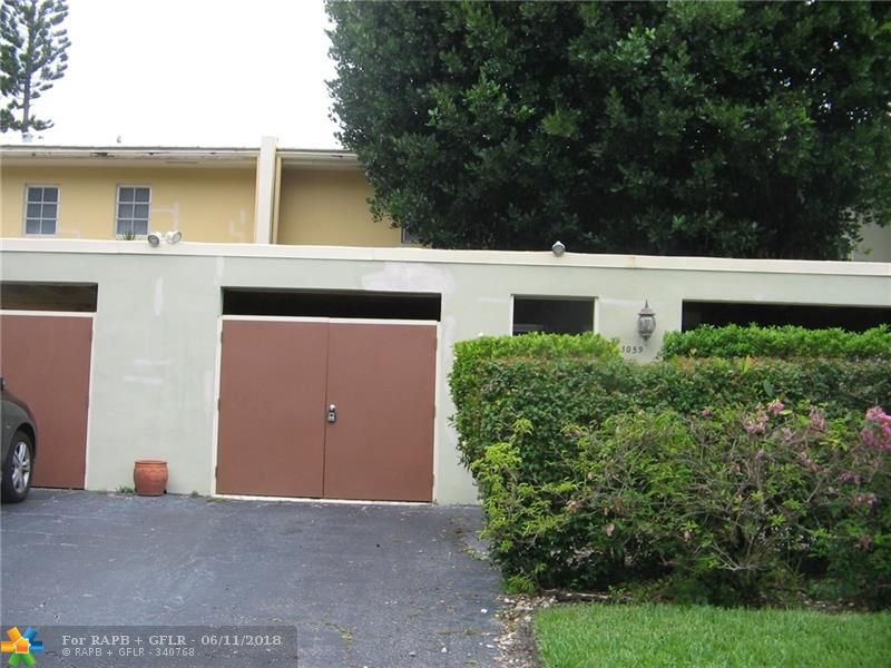 PRICE REDUCED, MOTIVATED SELLER, COME TAKE A LOOK! THIS 3 BEDROOM & 2 1/2 BATH TOWNHOME IN THE WELL KEPT AREA OF PALM AIRE FEATURES AN UPDATED KITCHEN, WOOD BURNING FIRE PLACE,  AMPLE CLOSET/STORAGE SPACE, PRIVATE CLOSED IN BRICK PAVERED CARPORT AREA, 2 PATIO AREAS & A LARGE BALCONY OVER LOOKING WALKING PATHS WITH CALMING LAKE VIEWS. JUST A SHORT DISTANCE TO THE COMMUNITY POOL,WYNDHAM HOTEL, ISLES CASINO, THE SKOLNICK CENTER, GEORGE BRUMMER PARK, PUBLIX, 3 GOLF COURSES & MAJOR ARTERIES OF TRAVEL.