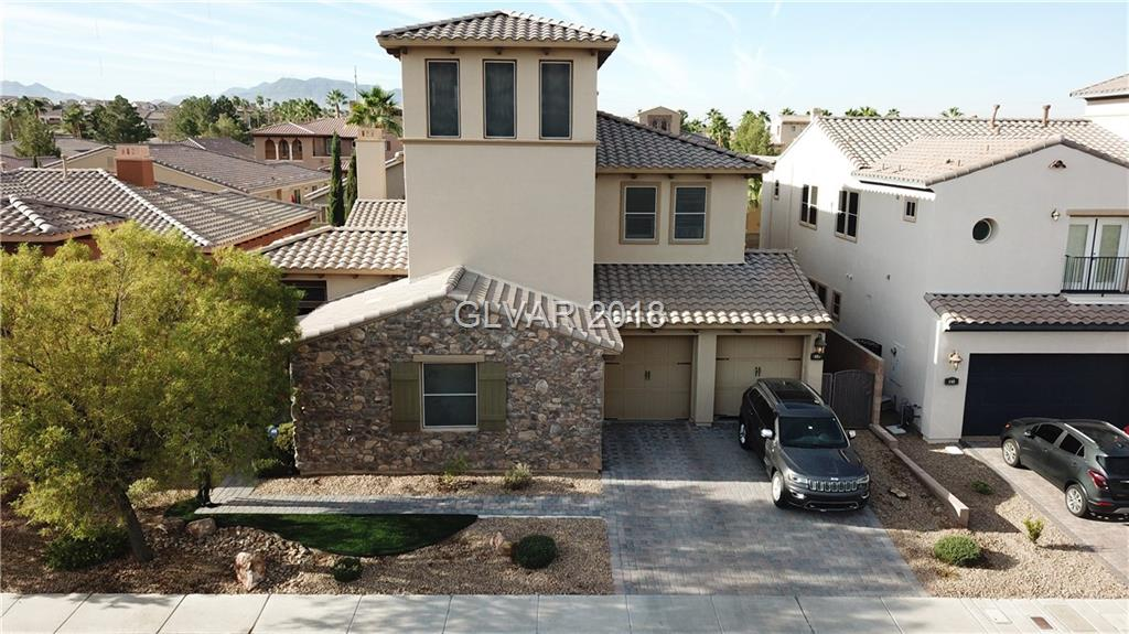 THIS LUXURY HOME IN THE GOLF COURSE TUSCANY COMMUNITY GRABS YOU AT FIRST SIGHT. A SECLUDED COURTYARD ROLLS INTO THIS 4 BEDROOM HOME WITH GOURMET KITCHEN, GRANITE COUNTERTOPS, CUSTOM CABINETS WITH X-LARGE ISLAND. HUGE MASTER SUITE WITH LUXURIOUS BATH. 3RD FLOOR LOFT/OBSERVATION ROOM WITH MOUNTAIN AND STRIP VIEWS. SPARKLING PEBBLE TEC POOL, 12' BASEBOARDS AND SHUTTER WINDOW COVERINGS THROUGHOUT FINISH IT OFF.  YOU DON'T WANT TO MISS!