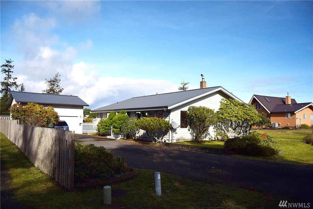Awesome Bay View home in the best location you will find in ocean shores. Enjoy spectular sunrises over the water with distant views of mountains and wildlife. Placed in the best beach town in the northwest property features everything you will need to live or vacation including a big detached garage new roof, new floors, hot tub, beautiful master suite with walk-in shower and separate tub. Custom design with wood ceilings and a brick fireplace structure enjoy peace and quiet of Ocean Shores.