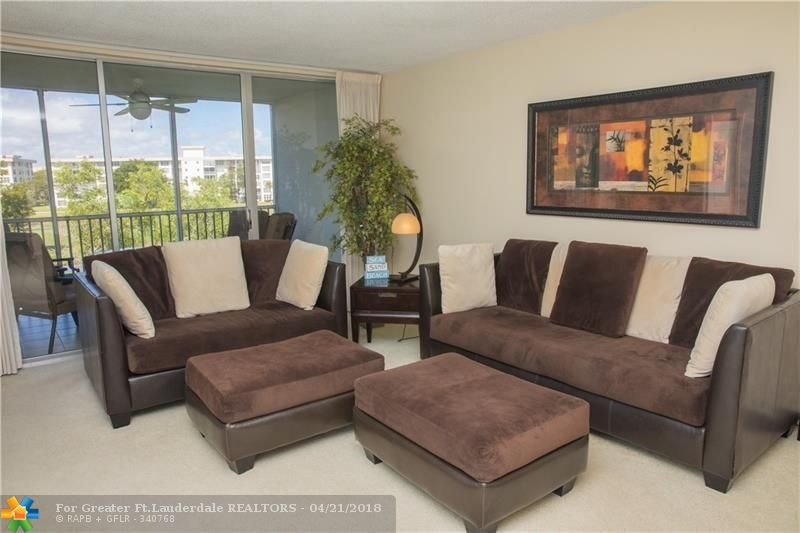 In the heart of Pompano Beach and on a golf course. If you want a condo with a view, search no more. This spacious penthouse offers a beautiful view of the golf course, 2 separate bedrooms with en suite bathrooms, a large kitchen that opens to the dining/living room area. Unit is tastefully furnished and decorated. Furniture can be purchased separately. All ages welcome. Association requires 20% down. Near Casino, shopping, restaurants. Short car ride to the beach.