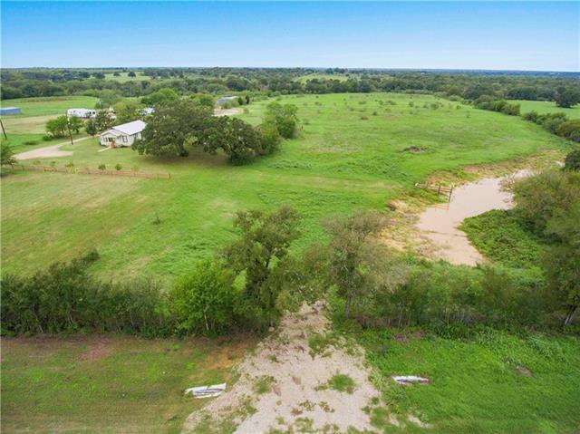 Lovely 11 acre rectangular parcel on Hwy 20 in Red Rock. Close to the intersection of 535 and 20. Approximately 320' of Hwy 20 frontage. New pond. New TX DOT permitted driveway. Currently in wildlife valuation. Build your ranch home with plenty of room to roam!