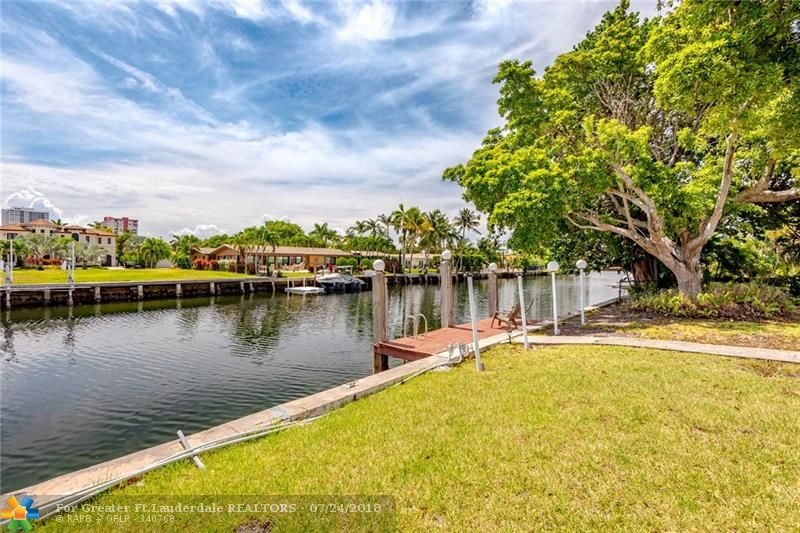 PRICED TO SELL 85 FT WATERFRONT HOME IN GOLD ISLES. GATED COMMUNITY, NO FIXED BRIDGES EASY ACCESS TO OCEAN AND INTERCOASTAL, DEEPWATER CANAL. HOME IS A 5/3 WITH A POOL, CIRCULAR DRIVEWAY & UPDATED KITCHEN. OFFERED WITH 637 OLEANDER DRIVE NEXT DOOR, FOR TOTAL 22,950 SQ FT LOT AND 170FT WATERFRONT. BUILD ONE HOME OR TWO BRAND NEW! PERFECT FOR VACATION RENTAL INCOME WHILE YOU MAKE PLANS TO BUILD. PURCHASED AS-IS, FURNITURE NEGOTIABLE.