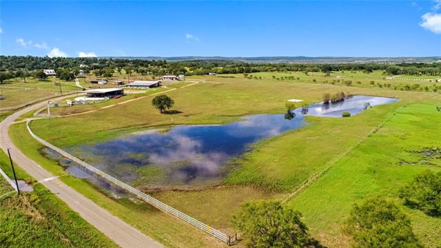 Stunning Horse Place only minutes from Marble Falls!!!! Approx 16 manicured acres with 18 stall horse barn with office and tons of extras, Coastal Field, 75 x 75 equipment/hay barn, large tank with fishing doc, 2 bedroom 2 bath barn-dominium. This is a very rare find. Several great building sites. A Must See Property! A horse lovers dream. Shown by appointment only, contact listing agent to schedule appointment.