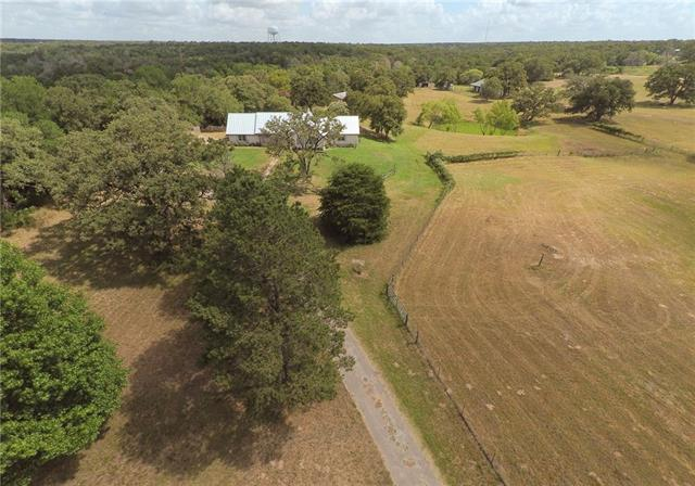 Love where you live on the this beautifully hidden gentleman's ranch on 17+ acres.  Tucked away behind mature oak trees & automatic gate, this well-maintained home is ideal for a primary residence, vacation, event venue. Conveniently located west of Bastrop, easy access to Hwy 71 - convenient commute to Austin & airport.  Perfectly designed for a variety of interests: large barn/workshop w/motor lift, working greenhouse, Aqua Water & well, rain barrels, loafing shed, pens on the property. Horses allowed.