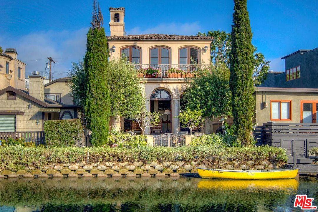 Island location on the Venice Canals. Truly a once-in-a-generation property, this elegant 3-story Tuscan-style home is among the largest & most coveted homes in the Venice Canals enclave.  Built & maintained with attention to detail, this home, designed by architect Louis Tomaro, features spacious rooms, balconies, high ceilings & designer touches throughout. Gourmet eat-in kitchen w/butler's pantry and Viking & Sub-Zero professional appliances. Oversized living room with 12-foot ceilings opening to large, waterfront yard w/mature olive & cypress trees. Spacious master bedroom suite w/sitting area, private balcony overlooking Howland canal, lavish bath with jetted spa tub & shower. Dramatic entry rotunda with flowing stairway & skylights; 3 large bedrooms (2nd bedroom is extra large, can be split to make a 4th bedroom), 3.5 baths. This timeless architectural masterpiece will bring your heart to the European countryside. Close to beach, Abbot Kinney and marina.