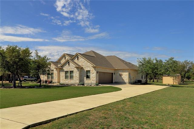 Immaculate one story custom home on 1 acre which backs up to Quarry Lake. House is 4 sides stone & includes plantation shutters, hand scraped wood floors, 3 full bathrooms & large kitchen which opens to family room. Oversized garage & back yard outbuilding provide plenty of storage space. Covered patio has motorized screen perfect for evening sun. Septic was recently serviced & property is plumbed for a pool. Don't miss on this one!
