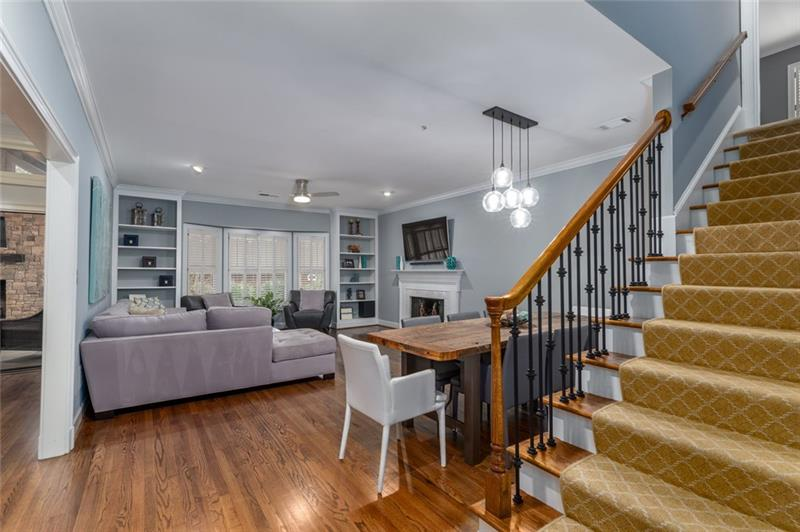 Add'l view of family/great room, dining area & staircase to upstairs full bedroom & full bath!