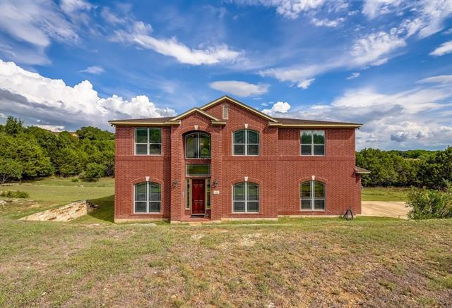 MOTIVATED SELLER~Spacious 5 bedrooms 5 bath home situated on 3 large combined lots that provides ample privacy within a serene environment~Floor plan is ideal for those who desire space to relax or entertain~Large kitchen w/ center island & prep sink contains granite counters & lots of storage space which opens to an expansive great room w/ soaring ceilings & fireplace~Master suite w/ walk-thru shower located on main level & 4 bedrooms plus gameroom located up~Enjoy amenities w/ lake access & parks~
