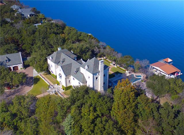 Trophy Estate of the Hill Country - 30+ acres of private, pristine land cover one of the highest hills in the area, with extraordinary views, crowning Lake Travis' main basin. European influenced manor, formal gardens, equestrian facilities, lighted arena, barn, tennis court, and MORE! Pool and spa overlook 650'+ of waterfront and one of the largest private docks on lake with tram access. 2BR/2BA vintage guest house. 3BR/1BA Manager's Apt. See Agent for lots included.