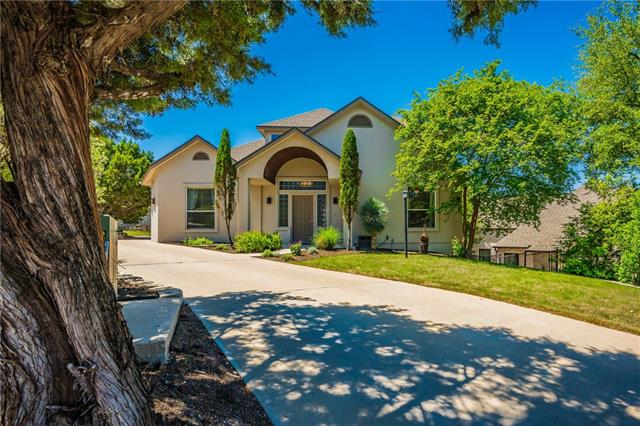 Beautiful Lakeway home on cul-de-sac w/hill country sunset views.Entertain in/out + ample parking.2 story foyer, open live/dine/kitchen w/lots of natural light on 1st floor.4 unique ceilings.3 beds/ 1 1/2 bath down, master suite up.Multi-level decks over garage & private back yard with views.Plenty of garage storage/walk in attic.Over $42,000 in upgrades.See attached for more info.Does not convey:Dart board upstairs, washer/dryer, TV's & TV mounts.Negotiable:Refrigerators, curtains & hardware.