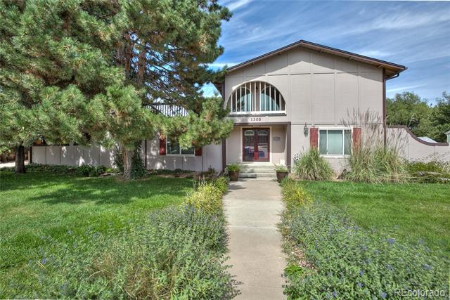 Unique home in all custom home subdivision. Stunning double door entry into cathedral foyer surround by 6' arched windows. Oversized kitchen features both eat in area and bar height counter top seating. Adjoining formal dining room w/ open views of family room & living room w/ cozy 36,000 BTU gas Heat N Glo fireplace. 26' family room attaches to West facing enclosed sun porch. 4 bedrooms on upper level w/ 2 master suites which walk out to upper balcony for mountain views. All bedrooms boast walk-in closets. Addl. 3rd bath on upper level. Basement offers 5th bedroom, daylight windows, 1/2 bath and 20' X 14' finished multi purpose room. Addl. unfinished storage area in basement . Plenty of parking with 2 car attached garage + 2 vehicle carport. Large RV parking in back. Backyard features mountain views & backs to creek for serene setting. New roof & gutters July 2018. New electrical panel & sprinkler system & double pane windows. Great entertaining home for large family gatherings!