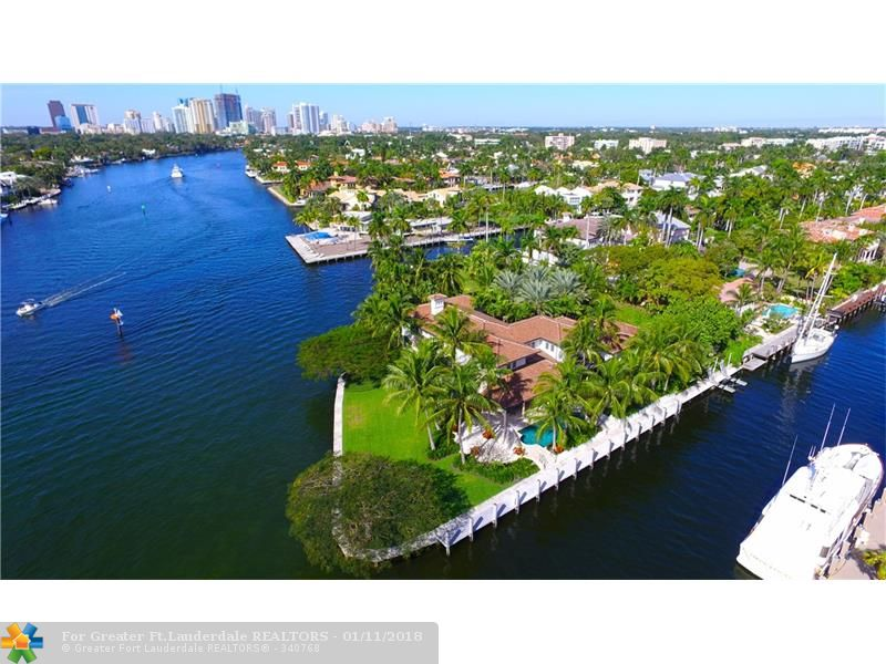Exquisite point lot estate w/mega yacht dockage, 425' of deep water frontage & spectacular wide water views! Renovated in 2011, this is one of the most gorgeous properties in South Florida. Impeccable craftsmanship throughout,  features include Venetian plaster walls, limestone & Siberian oak floors, beamed & coffered ceilings, fully equipped chef's kitchen, 2 fireplaces, wine cellar & gym. Crestron smart home, security system, impact doors & windows, full house generator. Prime south Las Olas location.