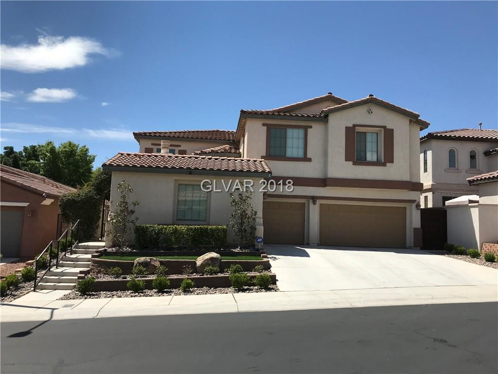You will adore the spectacular entrance to this Mountains Edge beauty with lovely front patio, fireplace, pebble flooring and raised 3 step entry. The backyard is a quaint oasis with a lattice gazebo, pool/spa and low maintenance landscaping. Interior boasts of Travertine flooring, huge kitchen and stainless steel appliances. All the bedrooms have connecting bathrooms, plus a great loft upstairs to keep the kids rooms clutter free. Gorgeous home!