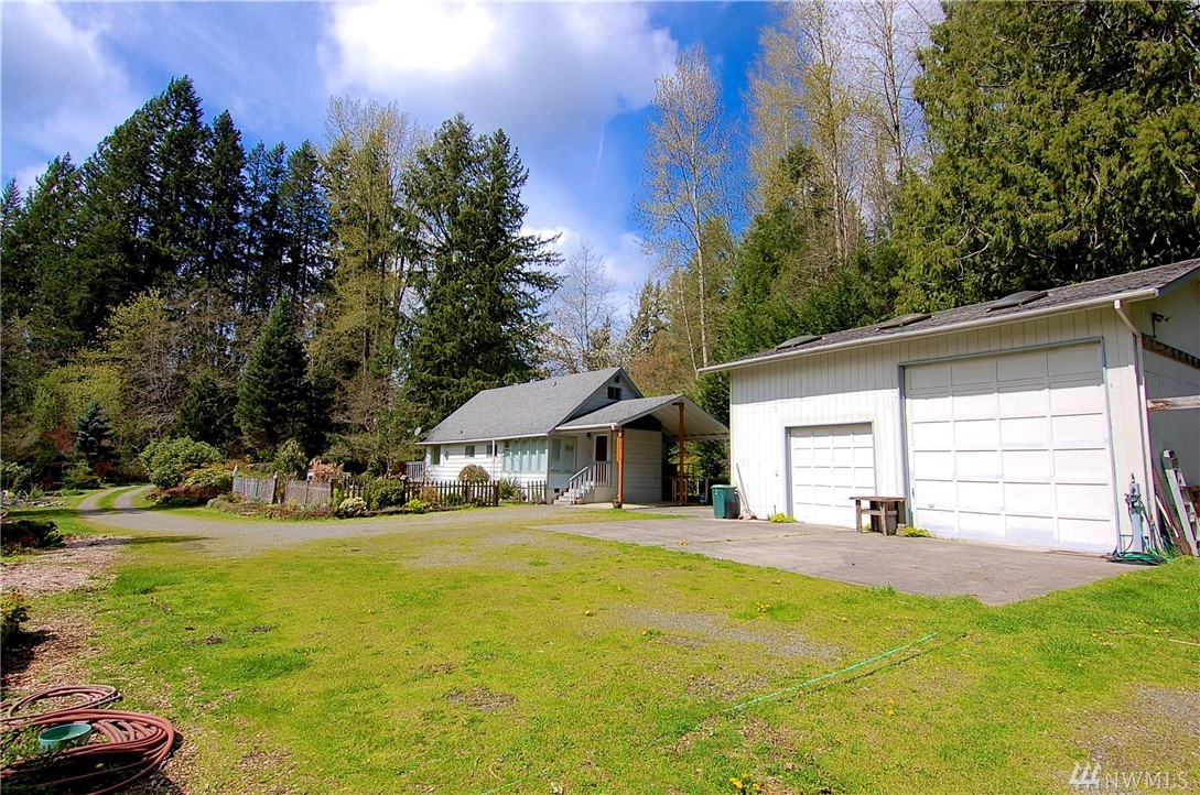 "Create your own slice of Serenity! Remarkable SUN drenched waterfront fixer home with new barn/shop. ""Wonderland"" setting with ponds, meadows, green house and the salmon spawning Bear Creek traversing the SE corner of the 2.8 acres. Update the  the 1530 sq ft 1930s farmhouse and create your own  park-like nirvana. house is cozy, comfortable & habitable.  . A million dollar setting so close to downtown Redmond and Microsoft. Visit to imagine yourself sanctified.  Transcendental"
