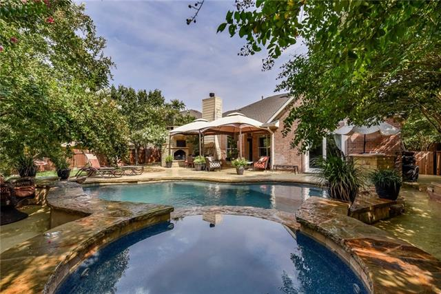Elegant one story home in highly coveted Teravista! Spacious floor plan w/ open kitchen/living concept. Custom kitchen cabinets, granite counters, & stainless appliances! Large master suite w/ double vanity+makeup vanity, separate shower/tub, & walk-in closet. MIL floor plan w/ 4 beds & 3 full baths! TOP OF THE LINE POOL w/ rock features, hot tub, inground cleaning system, & waterfall. Covered patio w/ stone fireplace & outdoor kitchen. Award-winning RRISD schools! Come by today & see it for yourself!