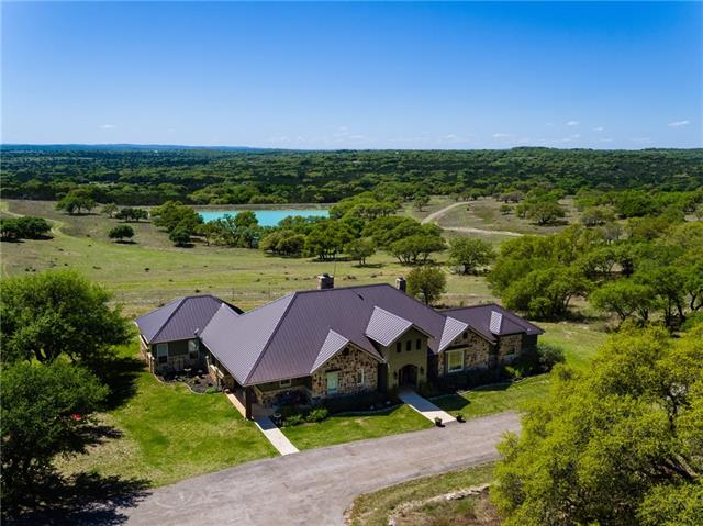 Very rarely will you find a ranch as well maintained as the Pico Ranch in Hays County. 110+/- rolling acres, pristine and manicured from corner to corner. From the gate, enjoy paved access to the Custom Hacienda/Ranch styled home and pool overlooking the entire property. Most of the cedar has been removed to allow the countless oak trees to thrive. 10+ acres of surface water stocked with bass and catfish. Exotic wildlife including Axis deer & Black Buck antelope. Close to everything, yet away from it all