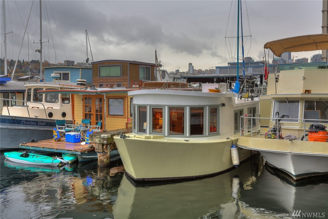 """Looking for an affordable condo alternative? This is the sweet little houseboat you have been waiting for! Located on a dock in prime South Lake Union that allows rentals (3 month minimum), this darling """"cabin""""on the water is a great investment. Cute as a button & cozy, it's the perfect little get away, pied-a-terre or condo alternative. So Seattle, so well-located, so easy to love! Close to transit, bike trail, restaurants, major employers & everything else!"""