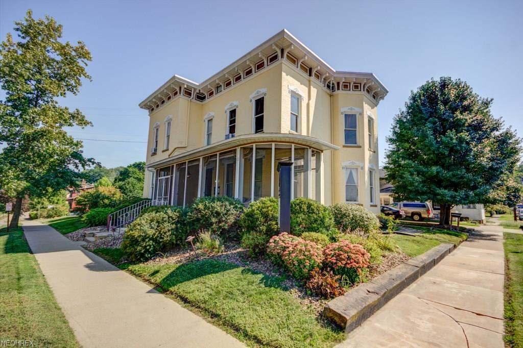 A MASTERPIECE! A picturesque, Italianate, 19th century brick mansion with 5000+ square feet that is currently utilized as office for a growing regional law firm in downtown Millersburg, OH, a local tourism and business hot spot. Formerly a bed and breakfast, this historic home built in 1885 is absolutely stunning with the original ornate woodwork, 4 decorative fireplaces, spacious suites, 6 bathrooms and has so much potential for a wide variety of uses. All of the architecture and design of the period are here. Starting on the exterior, the beautiful eaves cornice and the stone window pediments are something to behold. The long screened-in porch is magnificent and features wonderful views of the village. Beautiful landscaping, there's even a rose bush planted by the original owners. Inside, the stunning grand staircase truly is a work of art with a unique balustrade in pristine condition, original woodwork with maker's mark, the transom windows, and exceptional pocket doors, all make this property one for the history books. Other features include a full apartment with deck balcony over the garage, a first floor laundry room, a garage studio apartment, and a large unfinished attic with skylights (ready to turn into more usable space). Many updates throughout. Don't let someone else steal this once in a lifetime opportunity from you, come take a look today!