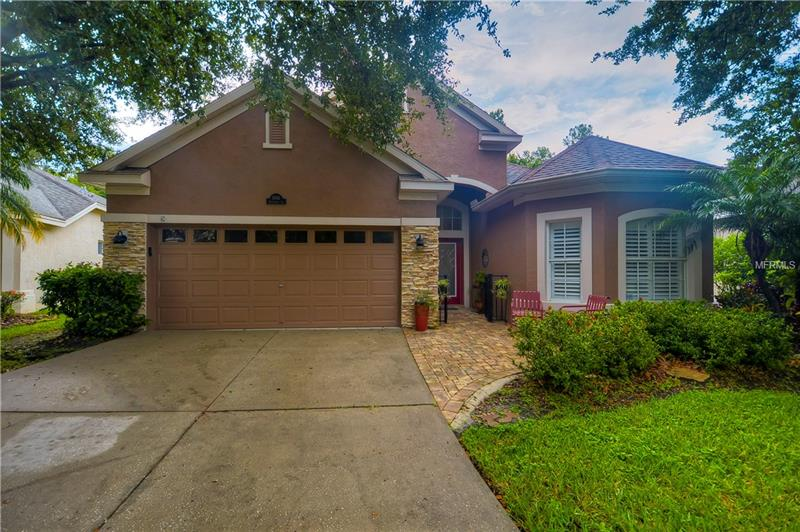 Beautiful home in The Greens of Westchase! Gorgeous conservation homesite. 3 bedrooms, 2 bathrooms, granite countertops, Cherry cabinetry