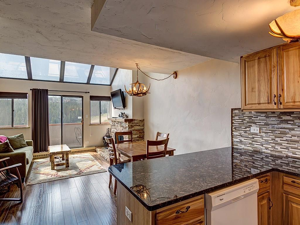 Exquisite remodel of this fabulous townhouse style Beaver Run condo overlooking the base of Peak 9 and the ski slopes.