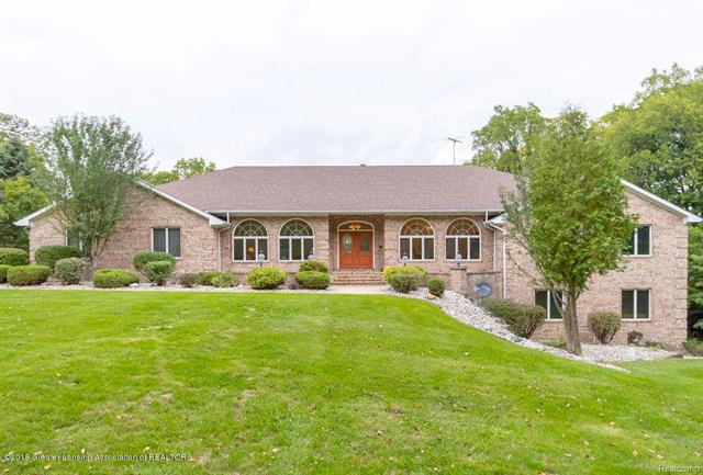 Amazing opportunity to own this sprawling brick ranch with over 7000sqft of living space on the River! First time on the market, you will fall in love as you drive up to this private setting and see the pride in ownership this family has maintained. Built in 1991 by Aiston on 1.89 acres with 150ft of river frontage in Dimondale! Dramatic entry with gorgeous archways, leads you to the Formal Dining and Living Rooms, as well as large Family Room with cathedral ceilings, hearth area surrounded by windows and open kitchen to entertain all the friends and family you could ever want! 3BR, First Floor Laundry as well as 2 Full Baths and Half Bath complete the main level.  The Lower Level is almost identical.  A 2nd Kitchen with stainless appliances, large eating area, family Room, 3 Bedrooms