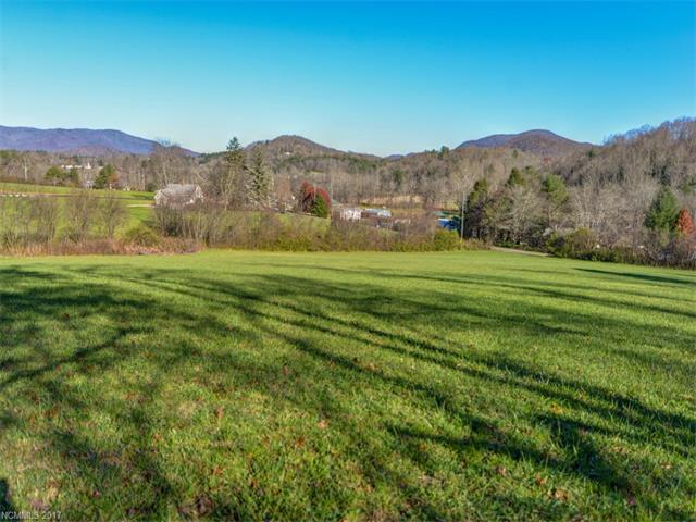 Beautiful 6.49 acre mini-farm in the new community of Cane Creek Views. The property has year round mountain views and rolling topography. Mature woodlands and pasture that is not steep. Bring your imagination and the horses and build your dream home and barn. All of this only 15 minutes to downtown Asheville.