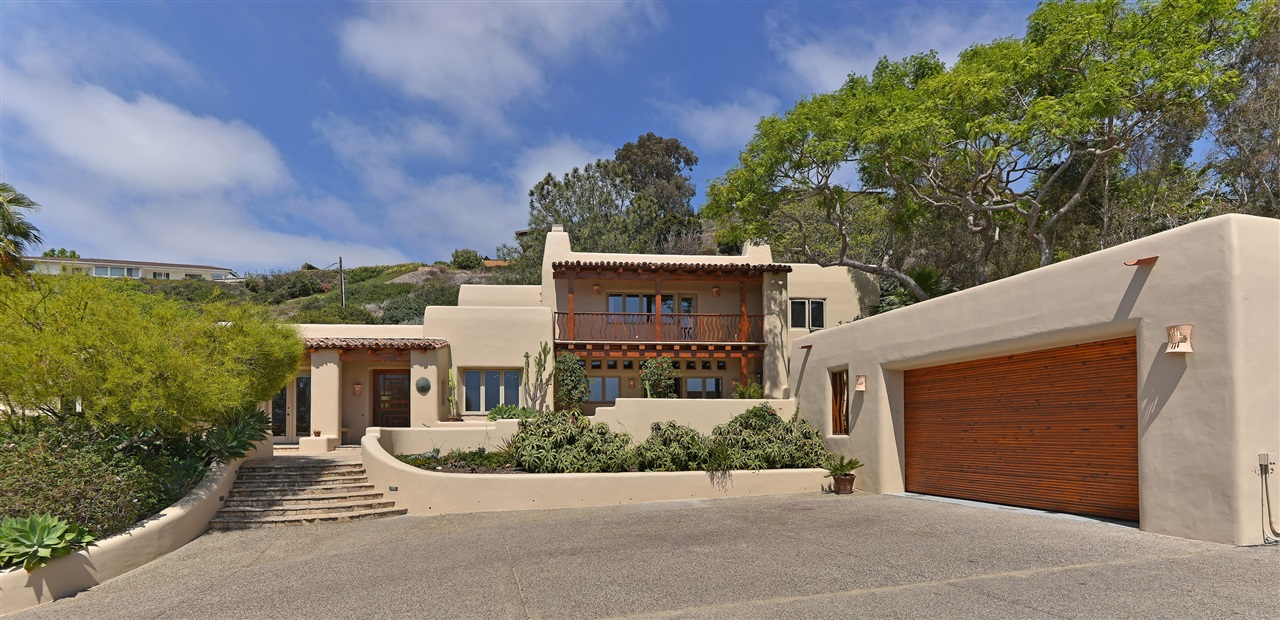 Welcome to a distinguished and unique custom home, location, and view where privacy, seclusion, and tranquility abound on 2 parcels totaling just under .7 acre!  Located above the bike path, with private entrance under the bridge, this 5 BR 4.5 BA home with significant ocean view was built by Louis Beacham in the Southwest/Santa Fe style. The floor plan is spacious and open, with 3 BR's on the main level and 2, including MBR, upstairs.Enjoy alfresco living with balconies and patios off all BR's except one. Among many beautiful details are latilla and viga ceilings, kiva fireplaces, rustic cabinetry, a spa and outside shower.  Private parking is available for 9+ cars, 2 in garage, which is easily expandable to a 4-car garage.  There is an extra storage/workshop room attached to the garage. *2 parcels are 351-620-02-00 (27,442 SF) and 351-020-01-00 (4034 SF) for a total of 30,476 SF.