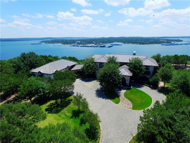 REDUCED!! +/- 4.032 Acres with +/- 243 feet of Lake Travis waterfront*Gorgeous home with panoramic Lake Travis views*No city taxes-LOW tax rate* Gated subdivision*4 boat slips convey in the DEEP WATER 15 slip subdivision marina*Amazing outdoor living space includes large outdoor kitchen with granite bar area, firepit, 10 person hot tub, negative edge swimming pool with waterfall and kiddie pool area*Theater room with 6 chairs* Huge game room* *Wine cellar*2 Master Bedrooms*Oversized kitchen pantry