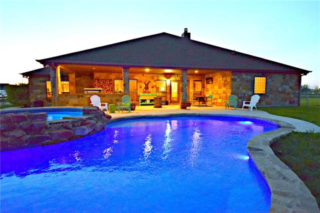 Expansive Single Story Ranch on over an acre and a half of land with open concept, stone accents, Hardwood floors and vast tall ceilings, crown molding and custom cabinetry. Gourmet Kitchen awaits you and your entertaining needs with granite and stainless appliances. Multi generational floorplan, Outdoor living is just a step outside to pool and hot tub, outdoor grill, and the relaxing on the large covered patio. Room to build a Secondary Garage for storage or business or RV Parking.