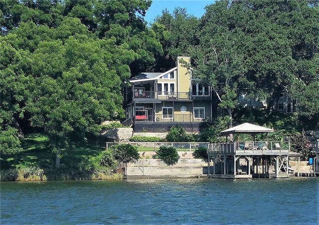 Beautiful on Lake Austin!  Enjoy main level living; spacious master suite, rich appointments, chef's kitchen, grand living room, utility corridor w planning center leading to garage w/ electric car chrg. Amazing floorplan; Lower level boasts 2nd living, two additional bedrooms, joined bath w/ sep vanities & wrap around balconies on both levels! 2 level dock w/ boat slip & pwc ramp each has electric lift. Swim platform, covered patios & gorgeous grounds. Clean line architecture & immaculately cared for!