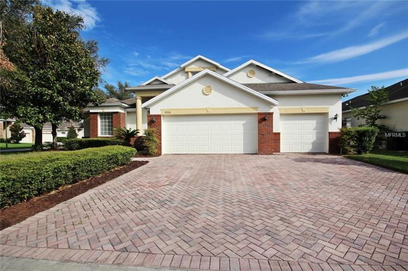 "Beautiful East Orlando home with a large 3 CAR GARAGE, situated on a spacious corner lot in GATED Mulberry Hollow. **NEW EXTERIOR & INTERIOR PAINT, WOOD & TILE FLOORS in living areas, NEW CARPET, FIRST FLOOR MASTER SUITE.**  Spacious open, airy interior creates a beautiful atmosphere featuring architectural details that include plant shelves in the family room, crown molding, 10& 12 foot ceilings throughout, poured insulation on outside walls, surround sound in family room, large interior laundry room to accommodate additional appliances, built-in vacuum system, abundance of window to allow the natural light to shine in, neutral color palettes and offers a secondary master bedroom downstairs.  Desirable open kitchen with stainless appliances, 42"" cabinets and a center island for extra prep space.  Inside first-floor office/hobby/ flex room adds to the thoughtfully flowing floor plan.  Secondary upstairs bedrooms with a  loft area offer plenty of space for your family and/or guests.  Split plan offers a private extended master retreat with a master bath that boasts a jetted tub, double shower heads, and a heater fan.  Kick back and relax on your covered lanai or enjoy the private fully fenced yard.  Just minutes to everything...short commute to UCF, 408 & 417, Waterford shops and nearby parks. Don't miss out on this EAST ORLANDO gem!"