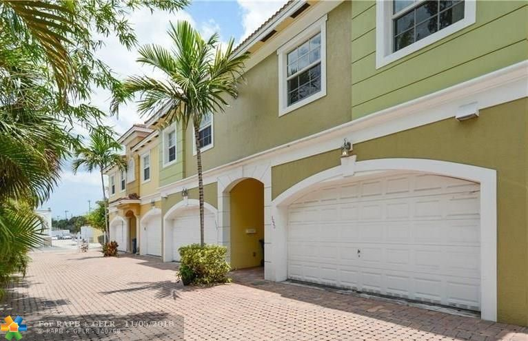 **RECENTLY UPDATED** 3 BR 2.5 BA 2 Car Garage Wilton Manors Townhouse / 2 levels. Updated kitchen/w SS appliances. Kitchen & baths have granite; attached 2 car garage.  Property features a fenced in patio large enough for a hot tub, Most of the windows are impact rated, open floor plan, Full Size (side by side) washer/dryer ON 2ND FLOOR. Large Master B/R with lots of storage. The stairs and entire 2nd floor has brand new carpet. No rental restrictions. Very solvent HOA with NO application process or fee and NO special assessments forthcoming. The property is centrally located and is less than a 10 minute walk to Wilton Drive and less then 10 minute drive to the beach. PRICED TO SELL!!!