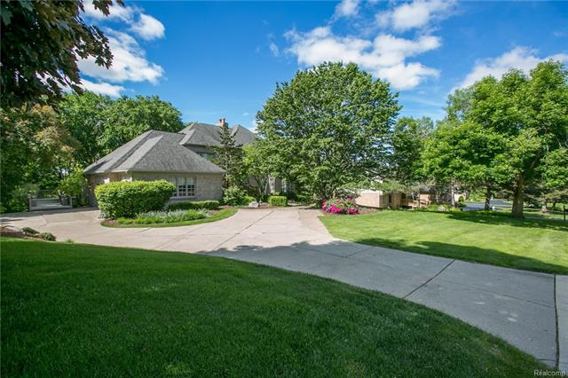 A slice of paradise tucked away near Heritage Park. This Farmington Hills estate has views for days & over 6000 finished sqft of living space. Elegant landscape greets you upon arrival. Sun flooded great room w/2-way FP & custom crown moldings. Spacious Library w/wet bar. Formal dining room. Huge updated bright eat-in white kitchen w/quartz counter tops, Viking appliances & huge center island w/seating has door wall to multi-tier deck. Kitchen opens to family room. Master Bedroom w/2-way FP, breakfast bar & walk-in closet w/organization system. Master bathroom suite w/dual sinks, walk-in shower & separate jetted tub. Two additional bedrooms each w/their own bathrooms. 2nd floor laundry room & walk-in cedar closet. Daylight walk out LL w/workshop, exercise room & living room w/door wall to patio. Home is primed for an in-law/Au-pair suite w/private room & bath. Plumbed & ready for full kitchenette. Many updates include: 2018 paint, 2017 furnaces & h20 tanks, 2011 roof, 2010 A/C units.