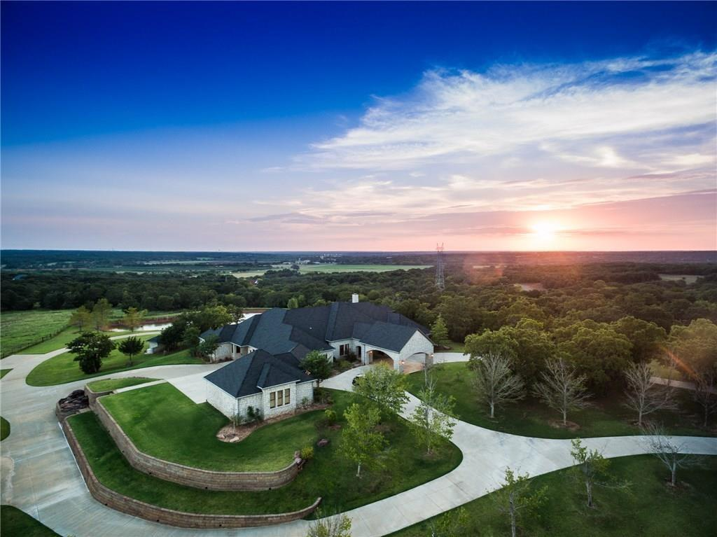 2017 COMPLETE UPDATE & REMODEL by 17 of Oklahoma's TOP DESIGNERS. This is the 2017 Designer Show House. Brand new kitchen and color schemes throughout the house. 40 acres of rolling hills, pond and mature trees that surround this gated estate home are ideal for a private equestrian/horse property. The most discerning buyer often cannot find the right combination of home, panoramic views, riding trails, land, location and amenities. The quality, custom details and materials along with the planning and construction of this home all contribute towards creating an estate like no other in the area. The beautiful 40 acres that surround the property make it a one-of-a-kind opportunity. All conveniently located to Edmond, NW Oklahoma City, Jones and Lake Arcadia. Amenities: Morton barn/horse stalls, geothermal, elevator, home theater, bonus room, stocked pond, workshop/garage (for more cars), his/hers closets, custom pool, etc. Incredible panoramic views of downtown OKC. Truly a luxury ranch.