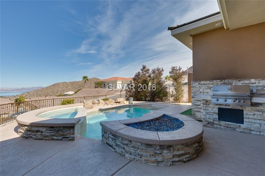 LOOK NO FURTHER YOUR DREAM HOME AWAITS.BREATH TAKING MOUNTAIN & LAKE VIEWS.GOURMET KITCHEN & CUSTOM CABINETS & ISLAND.HUGE MASTER BDR W/ FIREPLACE,HIS & HERS CUSTOM CLOSETS & BEAUTIFUL VIEWS.GREAT ROOM BOASTS GORGEOUS  STONE FIREPLACE, RETRACTABLE DOORS THAT EXPANDS YOUR LIVING ROOM TO THE GREAT OUTDOORS.MUST SEE INVITING BACKYARD W/ SPARKLING POOL/SPA & VIEWS OF THE LAKE, FIRE PIT & BBQ.RV GARAGES ARE HEATED/COOLED W/16FT CLEARANCE.